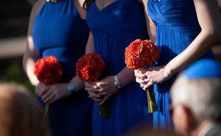 blue-bridesmaid-dresses-with-orange-bouquets
