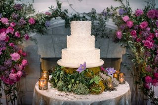 lace-patterned-three-tier-cake-on-a-table-with-succulents
