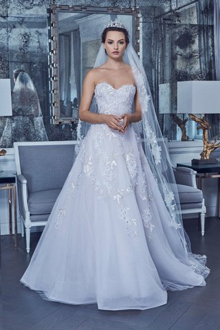 style-rk9408-lavender-white-gown-made-of-swarovski-floral-embroidered-lace-features-a-sweetheart-nec