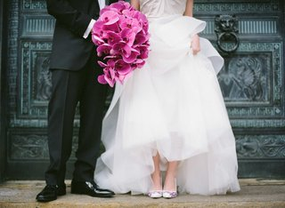 groom-and-bride-with-phalaenopsis-orchid-bouquet-and-hand-painted-wedding-shoes