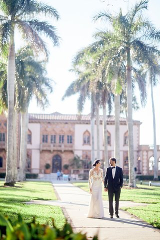 ca-dvan-ringling-mansion-wedding-with-palm-tree-lined-pathway