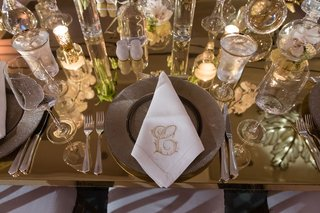 wedding-guest-place-setting-with-candles-glassware-monogram-napkin-stitch-c-letter-initial