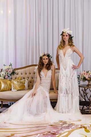 bride-in-tulle-ball-gown-and-fringe-wedding-dress-boho-v-neck-with-flower-crowns-on-settee-tufted