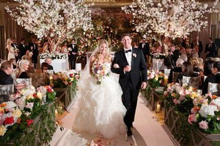 indoor-wedding-with-flowering-trees-and-lush-aisle