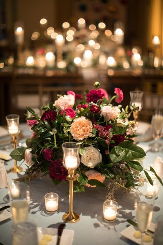wedding-centerpiece-garden-rose-dahlia-greenery-leaves-gold-candle-holders-votives-wedding-ideas