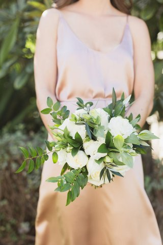 bridesmaid-bouquet-with-heavy-greenery-with-white-rose-accents