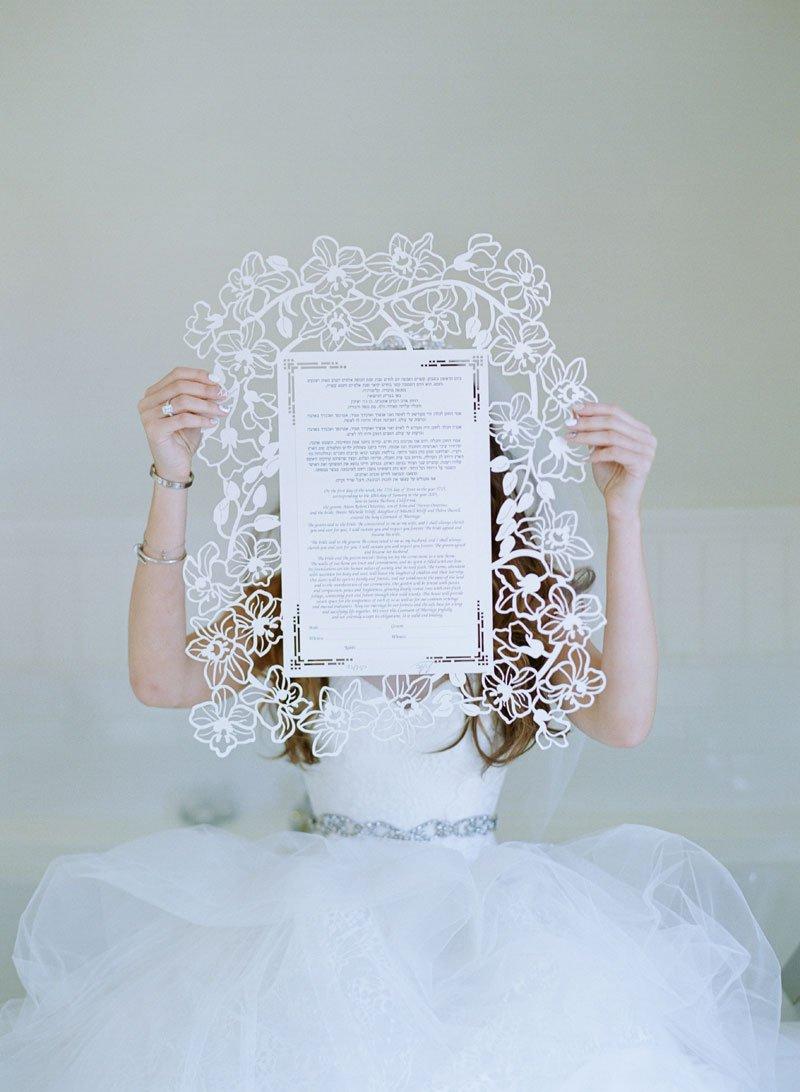 Bride Holding Laser-Cut Ketubah