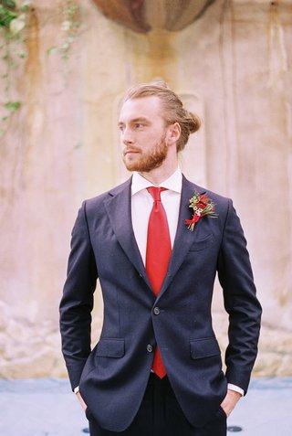 groom-navy-red-ensemble-suit-tuxedo-beauty-beast-movie-styled-wedding-shoot-prince-man-bun-hair