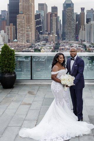 bride-in-mermaid-dress-off-the-shoulder-groom-in-suit-and-tuxedo-bow-tie-skyscrapers