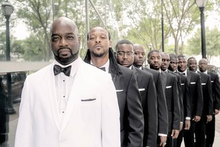 groom-in-white-tuxedo-and-groomsmen-in-black-tuxes