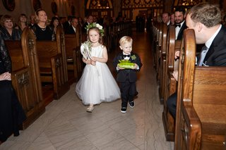 flower-girl-in-white-dress-with-flower-crown-and-wand-and-ring-bearer-in-little-suit-with-green-mum