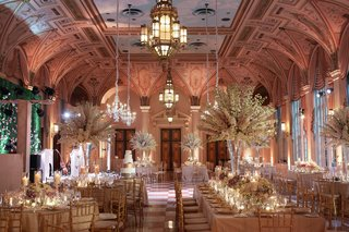 the-breakers-wedding-in-mediterranean-ballroom-with-tall-white-centerpieces-gold-checker-flooring