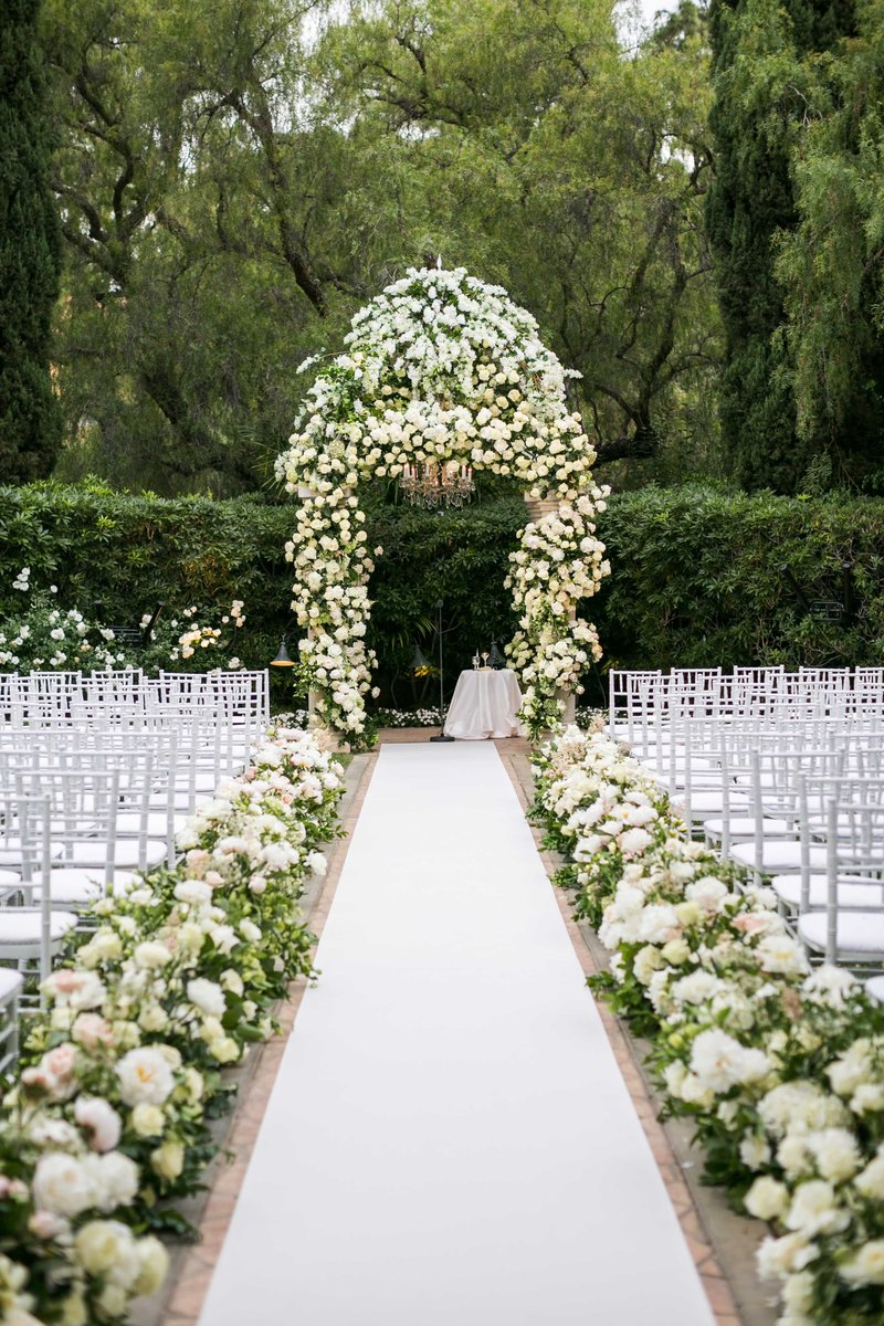 wedding ceremony aisle decorations crisp white aisle runner white greenery flowers
