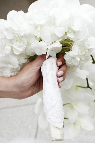 bride-holding-flowers-wrapped-in-handkerchief