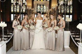 gold-metallic-bridesmaid-gowns-at-ceremony