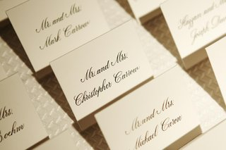 white-and-black-lettering-seating-card