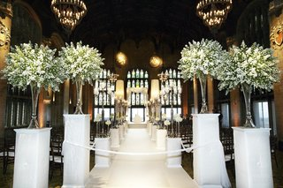 green-and-ivory-flowers-on-pedestals