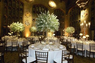 round-white-tables-with-tree-like-centerpieces