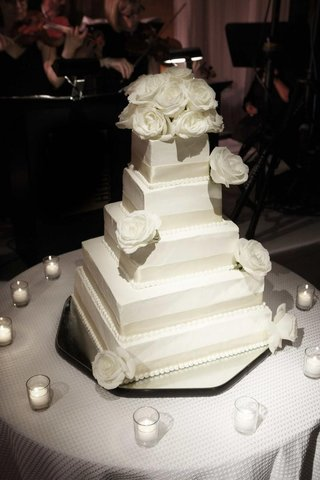 white-cake-with-ribbons-and-roses