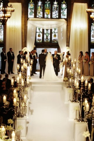 white-aisle-lined-with-silver-candelabra