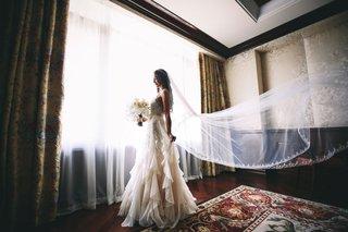 bride-in-elegant-inbal-dror-wedding-dress-with-peter-langner-veil-styled-by-maradee-wahl-bouquet