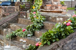montage-palmetto-bluff-wedding-reception-outdoor-green-garlands-floating-candles-on-historic-ruins