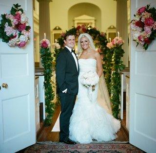 newlyweds-standing-in-doorway-of-ceremony-church
