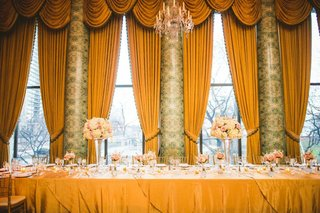 wedding-reception-head-table-tall-drapes-valances-hotel-wedding-ballroom-high-low-centerpieces