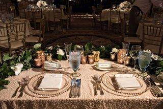 wedding-reception-half-moon-semi-circle-sweetheart-table-greenery-garland-beaded-charger-gold-votive