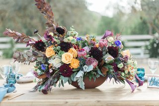 rustic-colorful-floral-centerpiece-california-winter-wedding-styled-shoot-boho-rustic-pops-unique