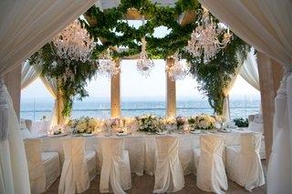 wedding-vow-renewal-dinner-intimate-setting-one-long-rectangular-table-flower-arrangements-low