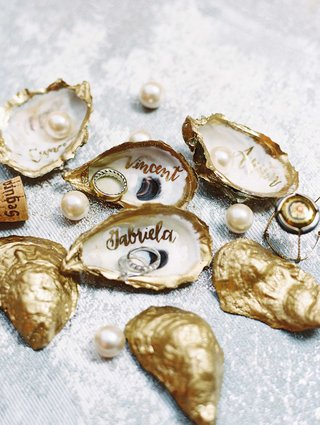 gold-painted-oyster-shells-with-calligraphy-names-and-mens-wedding-band-engagement-ring-diamond