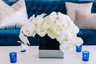 detriot-lions-quarterback-matthew-stafford-rehearsal-dinner-decor-blue-couch-white-flowers-candles
