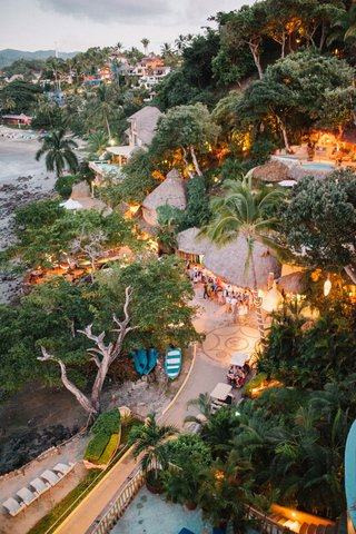 wedding-welcome-party-destination-wedding-in-mexico-venue-thatched-roof-ocean-beach-property-trees
