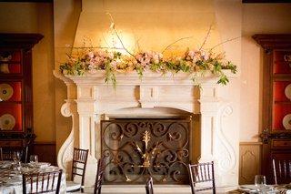 pink-roses-branches-amaranthus-foliage-on-mantel-piece-of-amaya-restaurant-grand-del-mar-resort