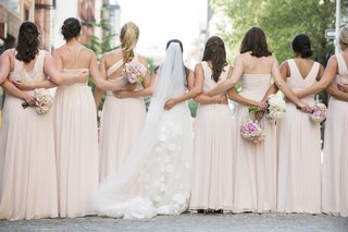 pink-bridesmaid-dresses-hugging-each-other-from-behind