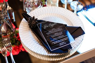 white-ridged-charger-plate-black-napkin-and-jeweled-napkin-ring-lucite-menu