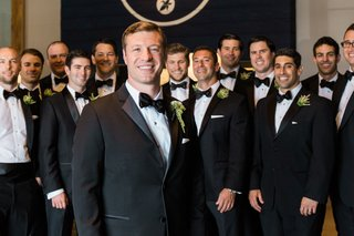 groom-and-groomsmen-black-and-white-tuxedoes-smile