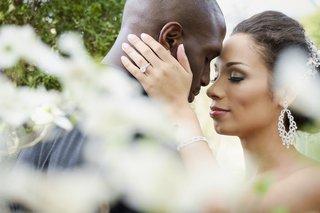 bride-with-jason-mccourty-wears-diamond-dangle-earrings-bracelet-and-sparkling-headband