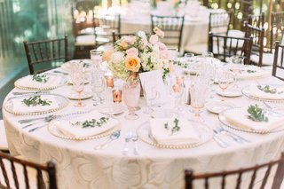 wedding-reception-round-table-wood-chair-low-centerpiece-pink-antique-crystal-goblets-greenery-plate