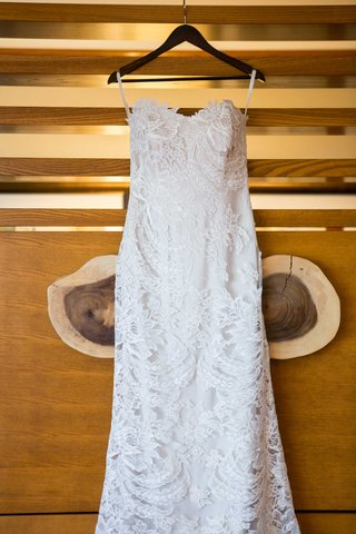 white-lace-fit-and-flare-gown-with-sweetheart-neckline-hanging-up