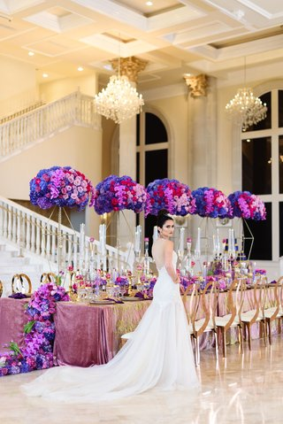 tall-floral-centerpieces-in-deep-purple-lavender-pink-and-red-hydrangeas-and-roses-geometric