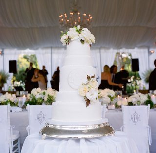white-five-layer-cake-with-fresh-flower-cake-topper
