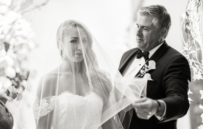 Father of Bride Removing Veil
