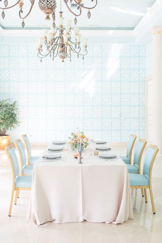 the-confused-millennial-blush-linen-light-blue-chairs-blue-wallpaper-palm-beach-wedding-reception