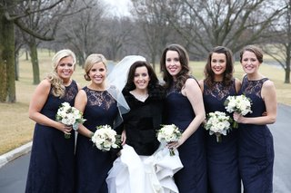 bridesmaids-in-amsale-navy-blue-bridesmaid-dresses-with-white-bouquets