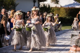 three-flower-girls-with-flower-crowns-moss-green-baskets-and-fluffy-tulle-grey-dresses