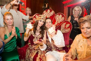 bride-and-groom-in-red-and-gold-attire-before-wedding