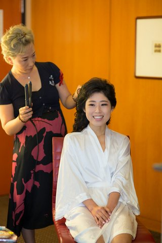 korean-american-bride-getting-hair-done-in-white-silk-robe