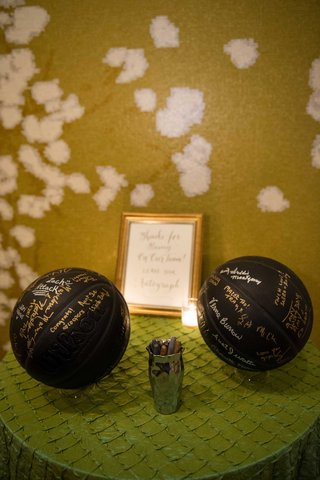 in-lieu-guest-book-couple-provided-black-basketballs-pens-to-sign-honor-groom-basketball-player